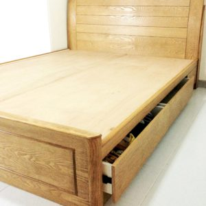 A storage bed made of solid plywood and finished with ash veneers and stained a light cocoa.