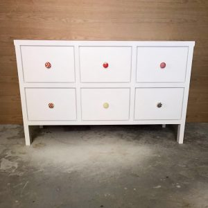Chest of drawers with hand painted knobs